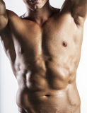 Muscle man. A naked body of European latin muscle man showing off royalty free stock photo