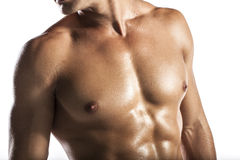 Muscle man. A naked body of European latin muscle man showing off stock photography