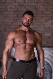Muscle man poses shows press Stock Photo