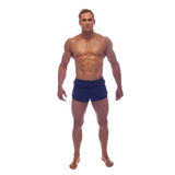 Muscle man posing in studio Royalty Free Stock Photography