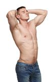 Muscle man posing in studio Stock Photo