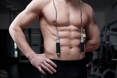 Muscle man with rope Stock Images