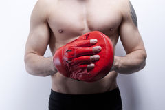 Muscle man's body in gym Stock Photo