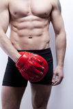 Muscle man's body in gym Royalty Free Stock Images