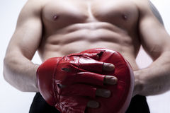 Muscle man's body in gym Stock Images