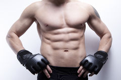 Muscle man's body in gym Royalty Free Stock Image