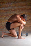 Muscle man thinking with thinker posture stock photography