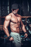 Muscle man who is posing. In club royalty free stock images