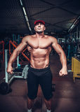 Muscle man who is posing Royalty Free Stock Image