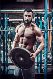 Muscle man who is posing Stock Photo