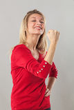 Muscle and power concept for thrilled blond 20s woman Royalty Free Stock Photography
