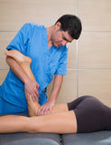 Muscle power therapy on woman leg knee. Muscle power therapy on women leg knee by therapist Stock Photography