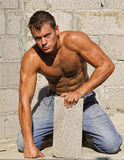 Muscle sexy naked dirty young worker with block Stock Photos