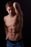 Muscle sexy naked young man posing in jeans Stock Photo