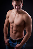 Muscle sexy naked young man posing in jeans Royalty Free Stock Photography