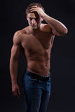 Muscle sexy naked young man posing in jeans Royalty Free Stock Photo