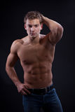 Muscle sexy naked young man posing in jeans Royalty Free Stock Photos