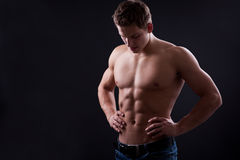 Muscle sexy naked young man posing in jeans Royalty Free Stock Image
