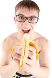 Muscle sexy wet naked young man eating the banana Royalty Free Stock Image