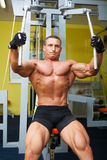 Muscle shaped man exercise on sport gym Stock Photo