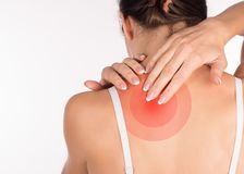 Muscle spasm. Woman with neck and shoulder pain and injury, back view, close up, isolated on white stock photo