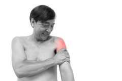 Muscle strain. Old aged thai man grasp his arm. And blank area at right side Royalty Free Stock Images