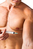 Muscle and syringe Stock Photos