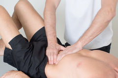Muscle tissue massage royalty free stock photography