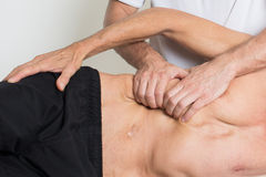 Muscle tissue massage stock image