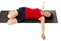 Muscle training. A young woman on the floor exercise Stock Photography