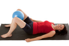 Muscle training. A young woman with a small stability ball Stock Images