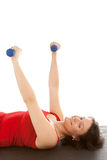 Muscle training. A young woman on the floor exercise royalty free stock image