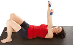 Muscle training. A young woman on the floor exercise stock photos