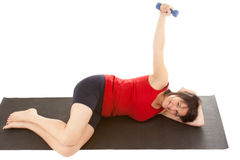 Muscle training. A young woman on the floor exercise stock images