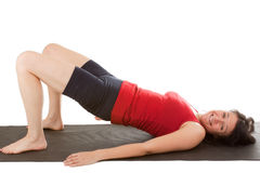 Muscle training. A young woman on the floor exercise royalty free stock photo