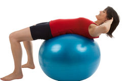 Muscle training. A young woman with a large exercise ball Royalty Free Stock Photography