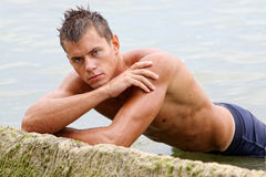 Muscle wet naked sexy man in sea water Stock Photography