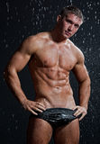 Muscle wet sexy naked man posing under the rain Stock Photo