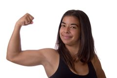 Muscle Woman. Portrait of a fit young athlete showing off her bicep. Isolated on white royalty free stock image