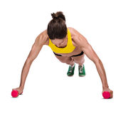 Muscle woman makes fitness excercise Stock Photography