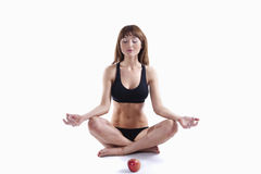 Muscle Woman With Apple Royalty Free Stock Image