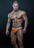 Muscled модель с чернилами стоковые фотографии rf