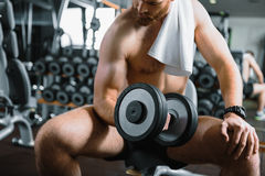 Muscled bearded sportsman in gymnasium Stock Images