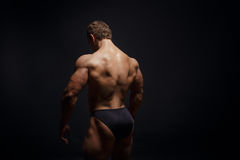 Muscled bodybuilder showing his back Royalty Free Stock Photography