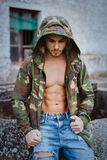 Muscled boy with camouflage jacket Stock Images