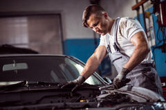 Muscled car mechanic Royalty Free Stock Photography