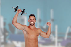 Muscled guy lifting weights Stock Photos