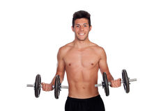 Muscled guy lifting weights Royalty Free Stock Photos