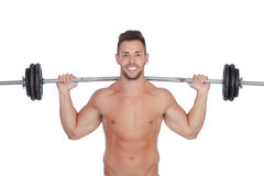 Muscled guy lifting weights Stock Image