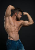 Muscled male model Konstantin Kamynin. Muscled male model in studio Royalty Free Stock Images